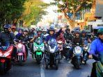 Kembalikan Berkas Pendaftaran Di Kantor Nasdem, Danny Kendarai Sepeda Motor